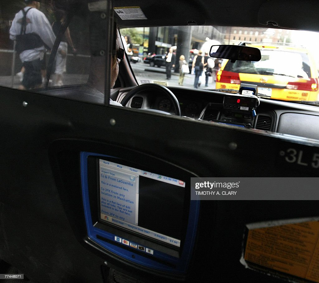 A New York City cab driver waits in line on 6th Avenue 22 October 2007, with one of the new touch screen devices help passengers by making payments more convenient and lost items easier to locate. City cabbies went on strike today to protest new rules requiring installation of the new devices that would let passengers watch TV, pay with credit cards and check their location on GPS.