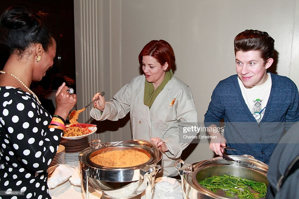 New York City City Council Speaker Christine Quinn and chef Justin Warner volunteer during the Our Table Is Yours - A Thanksgiving Day benefit at Cipriani, Wall Street on November 21, 2012 in New York City.