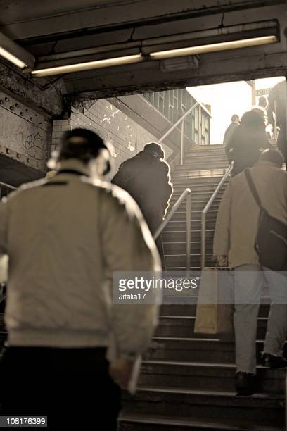 New York  City Commuters Clambering up Subway Steps