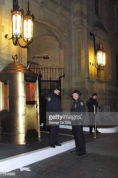 New York City cops stand guard outside the Dakota apartments on the 20th anniversary of musician John Lennon''s murder December 8 2000 in New York...