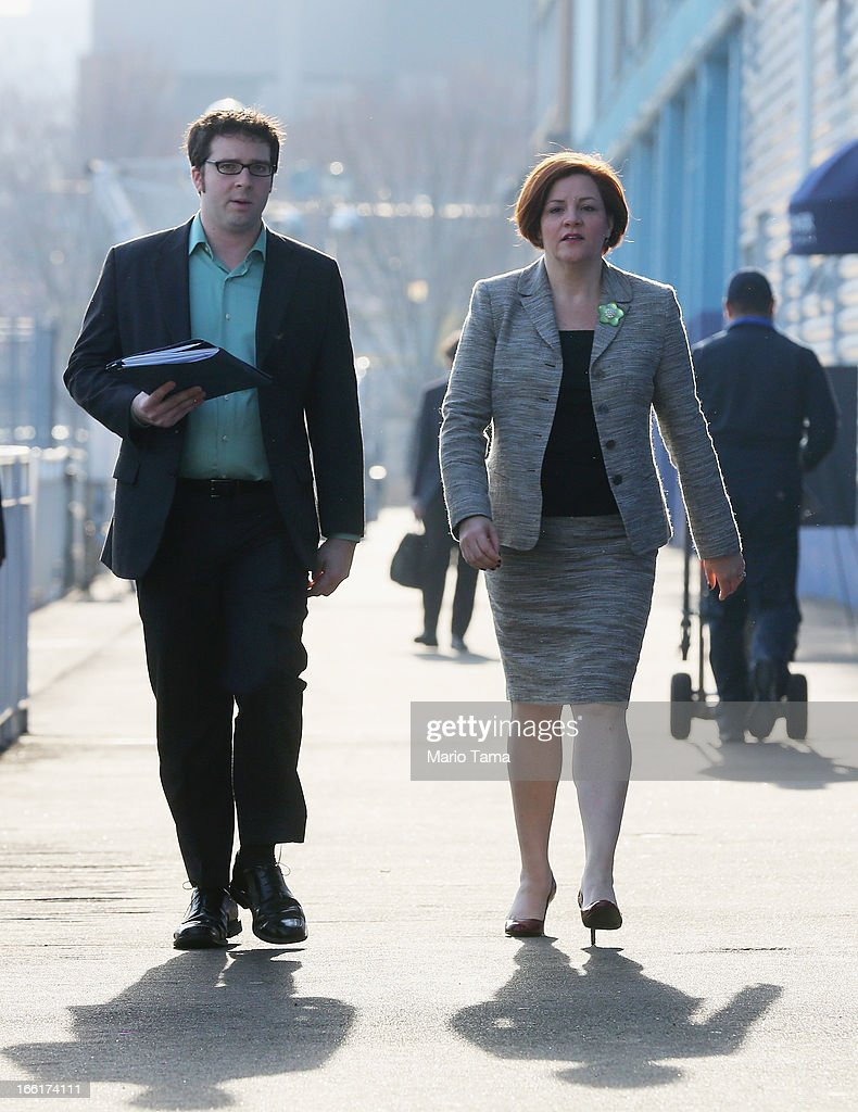 New York City Council Speaker and mayoral candidate Christine Quinn (R) walks before entering a political forum on a boat in Manhattan on April 9, 2013 in New York City. Six mayoral candidates spoke at the Metropolitan Waterfront Alliance's 2013 Waterfront Conference ahead of the November 2013 mayoral election.