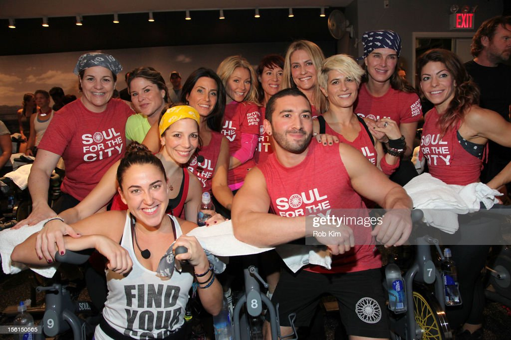 New York City Council Speaker Christine Quinn, Jenna Bush, instructor Laurie Cole, tv personality Kelly Ripa, instructor Janet Fitzgerald, instructor Melanie Griffith, actress Brooke Shields and instructor Kym Perfetto (L-R Front) instructor Jenny Gaither, instructor Jolie Walsh and instructor Ben Tarshen attend SoulCycle's Soul Relief Rides at SoulCycle Tribeca on November 11, 2012 in New York City.