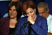 New York City Council Speaker Christine Quinn speaks next to her wife Kim Catullo during her concession speech in the New York Democratic mayoral...