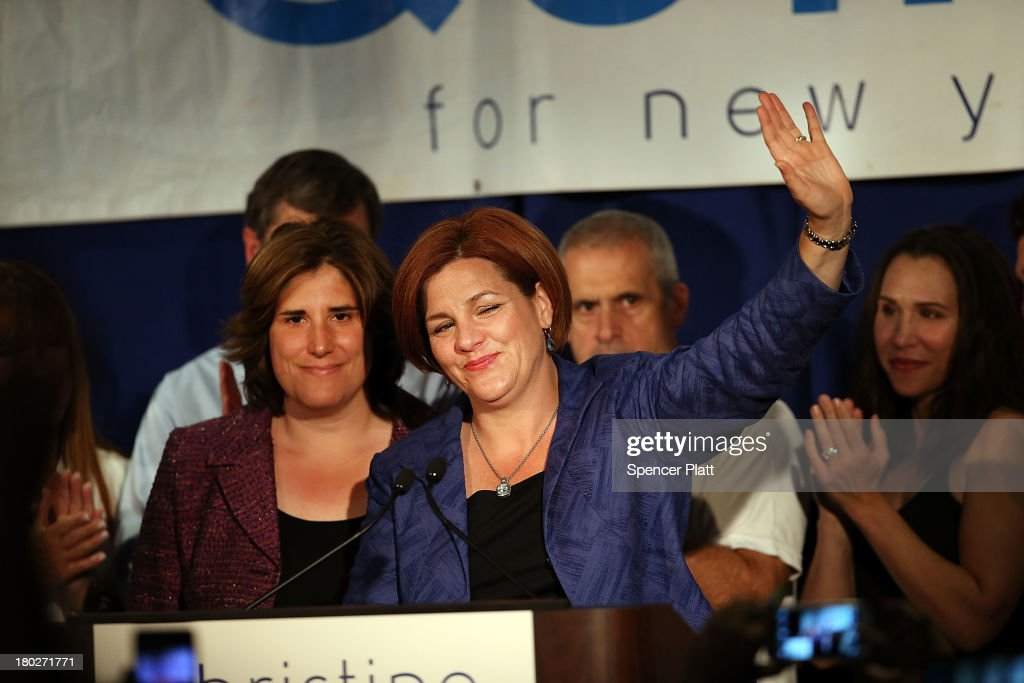 New York City Council Speaker <a gi-track='captionPersonalityLinkClicked' href=/galleries/search?phrase=Christine+Quinn&family=editorial&specificpeople=550180 ng-click='$event.stopPropagation()'>Christine Quinn</a> waves with her wife Kim Catullo (L) while giving her concession speech in the New York Democratic mayoral primary elections on September 10, 2013 in New York City. Quinn, who lead early in the polls and who was endorsed by all of New York's major newspapers, saw her lead slip away in the final weeks of the campaign. Quinn would have been the first woman and lesbian to hold the job of mayor.