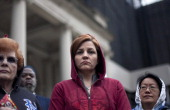 New York City Council Speaker Christine Quinn wears a hoodie attends a press conference to call for justice in the February 26 killing of 17yearold...