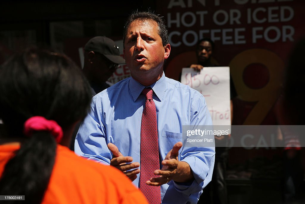 New York City Councilman Brad Lander speaks to employees at Wendy's fast-food restaurant during a demonstration outside of one of the restaurants to demand higher pay and the right to form a union on July 29, 2013 in New York City. Across the country thousands of low-wage workers are expected to walk off their jobs Monday at fast food establishments in seven U.S. cities. Workers at KFC, Wendy's, Burger King, McDonald's and other restaurants are calling for a living wage of $15 an hour and the right to form a union without retaliation.