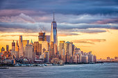 New York City financial district on the Hudson River at dawn.