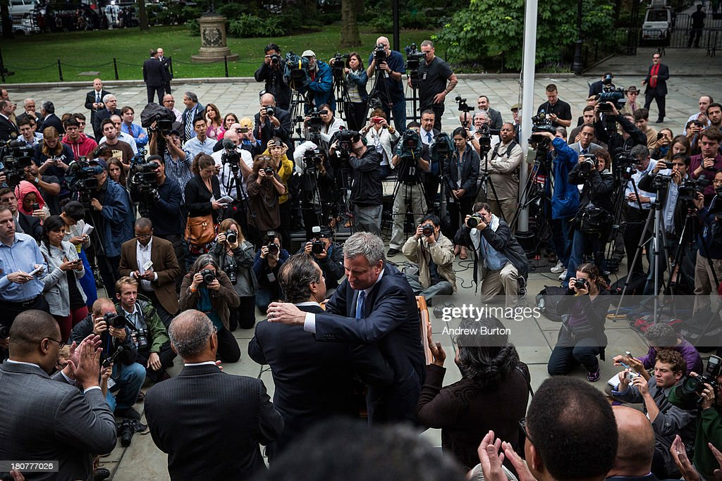 New York City Democratic mayoral candidate Bill De Blasio (L), hugs New York Governor <a gi-track='captionPersonalityLinkClicked' href=/galleries/search?phrase=Andrew+Cuomo&family=editorial&specificpeople=228332 ng-click='$event.stopPropagation()'>Andrew Cuomo</a> after speaking outside New York City Hall after mayoral hopefull Bill Thompson (not seen) conceded the Democratic party candidate position to De Blasio on September 16, 2013 in New York City. Thompson and De Blasio both hoped to win the democratic cadidate position for New York City. While De Blasio had a majority lead in the primary vote with approximately 40% of the votes, Thompson had hoped that he could force a run off between the two. New York Governor <a gi-track='captionPersonalityLinkClicked' href=/galleries/search?phrase=Andrew+Cuomo&family=editorial&specificpeople=228332 ng-click='$event.stopPropagation()'>Andrew Cuomo</a> (L) also attended the speech.