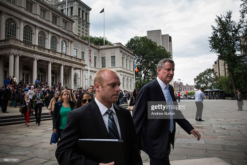 New York City Democratic mayoral candidate Bill De Blasio (R), leaves New York City Hall after speaking after mayoral hopefull Bill Thompson (not seen) conceded the Democratic party candidate position to De Blasio on September 16, 2013 in New York City. Thompson and De Blasio both hoped to win the democratic cadidate position for New York City. While De Blasio had a majority lead in the primary vote with approximately 40% of the votes, Thompson had hoped that he could force a run off between the two. New York Governor Andrew Cuomo (L) also attended the speech.