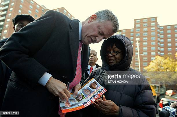 New York City Democratic mayoral candidate Bill de Blasio signs an autograph as he campaigns in the Queens borough of New York November 4 2013 AFP...