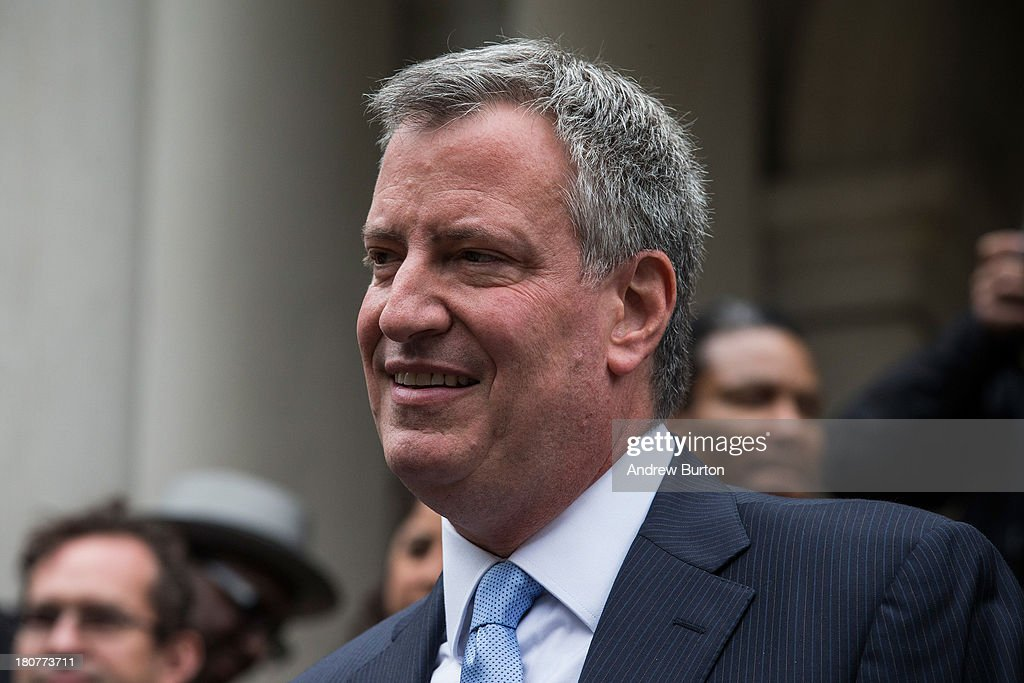 New York City Democratic mayoral candidate Bill De Blasio, speaks outside New York City Hall after mayoral hopefull Bill Thompson (not seen) conceded the Democratic party candidate position to De Blasio on September 16, 2013 in New York City. Thompson and De Blasio both hoped to win the democratic cadidate position for New York City. While De Blasio had a majority lead in the primary vote with approximately 40% of the votes, Thompson had hoped that he could force a run off between the two. New York Governor Andrew Cuomo (L) also attended the speech.