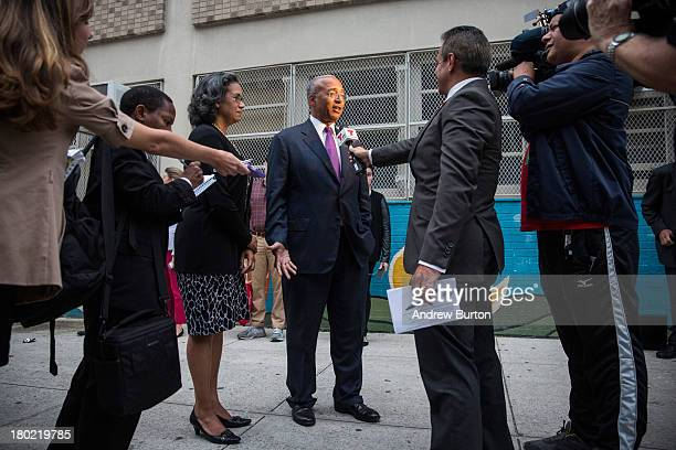 New York City Democratic mayoral hopeful Bill Thompson speaks with members of the media after voting at his polling station in Harlem on September 10...