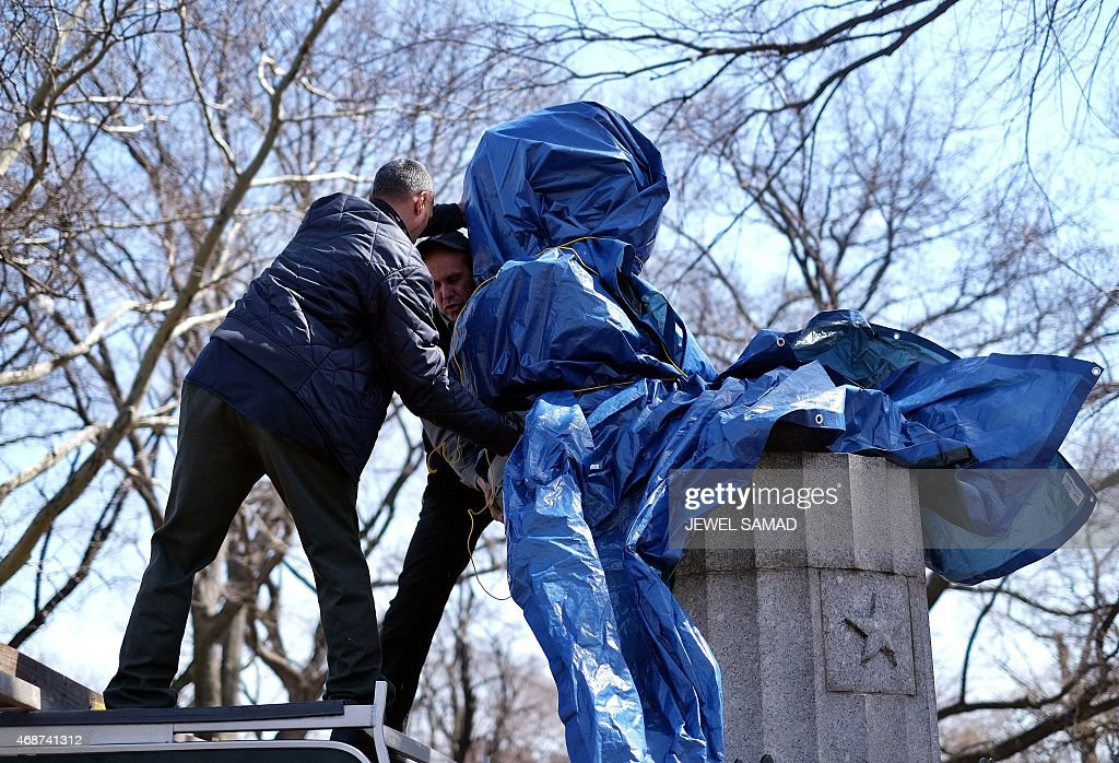 New York City Department of Parks and Recreation employees take down a statue of former National Security Agency (NSA) contractor <a gi-track='captionPersonalityLinkClicked' href=/galleries/search?phrase=Edward+Snowden&family=editorial&specificpeople=10983676 ng-click='$event.stopPropagation()'>Edward Snowden</a> at the Fort Greene Park in Brooklyn, New York, on April 6, 2015. A group of artists on Monday installed a bust of fugitive US intelligence analyst <a gi-track='captionPersonalityLinkClicked' href=/galleries/search?phrase=Edward+Snowden&family=editorial&specificpeople=10983676 ng-click='$event.stopPropagation()'>Edward Snowden</a> on a war memorial in a New York park, though authorities quickly removed the illicit statue. Snowden, 31, a former contractor at the US National Security Agency, has lived in exile in Russia since 2013 after revealing mass spying programs by the United States and its allies.