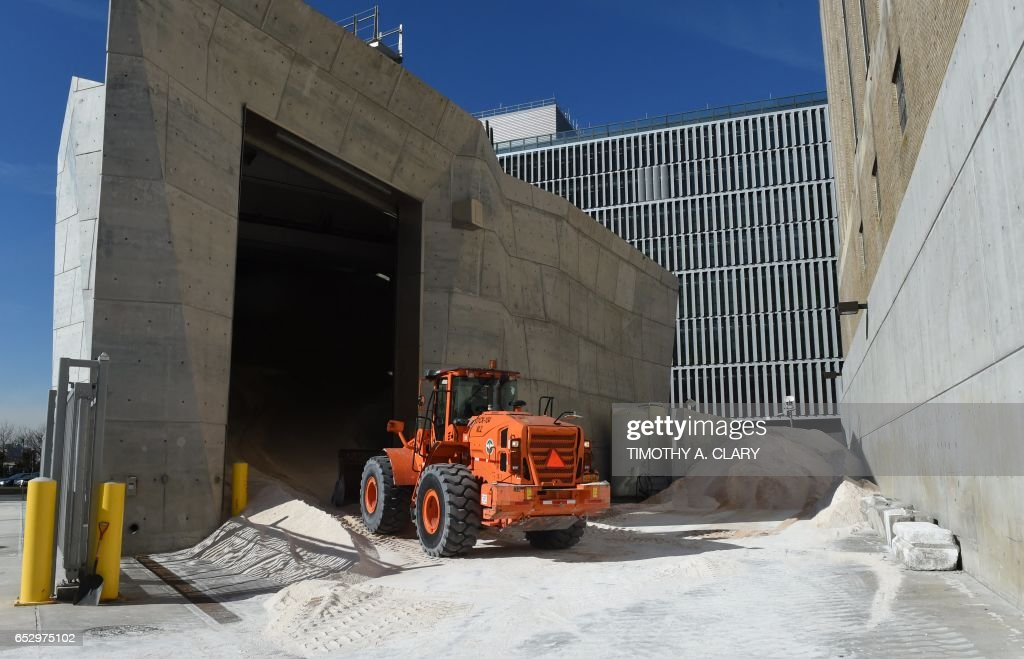 A New York City Department of Sanitation plow moves sand around in the west side depot March 13, 2017 to be used over the next two days as the city braces for a nor'easter that could dump as much a...