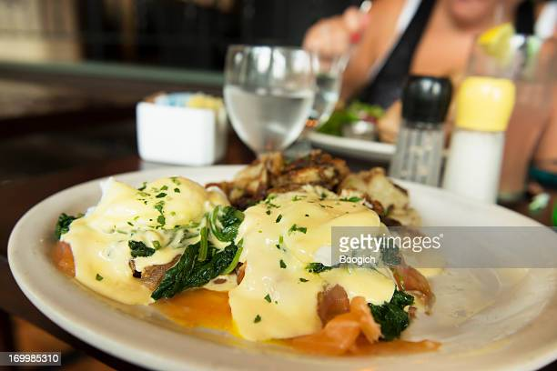 New York City Eating Brunch Eggs Benedict In Restaurant