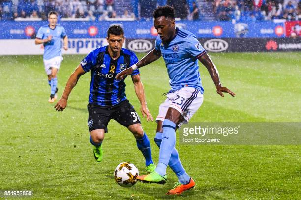 New York City FC forward Rodney Wallace gains control of the ball facing Montreal Impact midfielder Blerim Dzemaili during the New York City FC...
