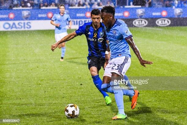 New York City FC forward Rodney Wallace gains control of the ball over Montreal Impact midfielder Blerim Dzemaili during the New York City FC versus...