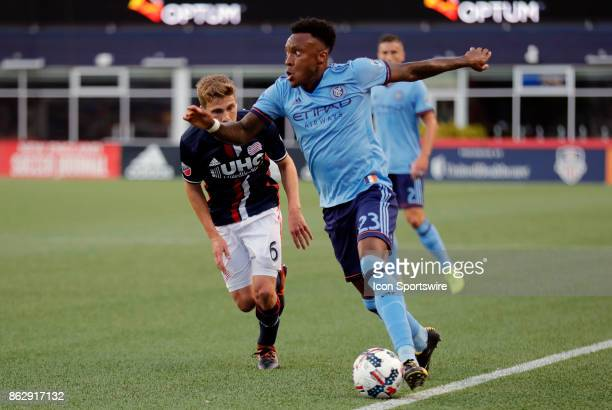 New York City FC forward Rodney Wallace works the touch line watched by New England Revolution midfielder Scott Caldwell during a match between the...