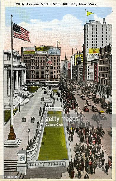 New York City Fifth Avenue North from 40th Street New York Overlooks New York Public Library to the left of Fifith Avenue Pedestrians and cars in the...
