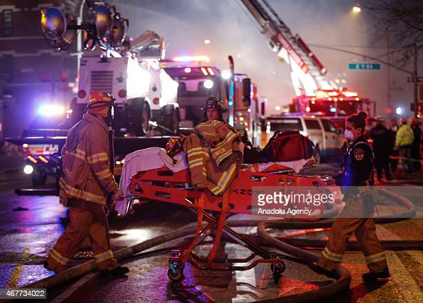 New York City Fire Department personel are on the scene of a fire broke out after a massive explosion in a building on 2nd Avenue of Manhattan's East...