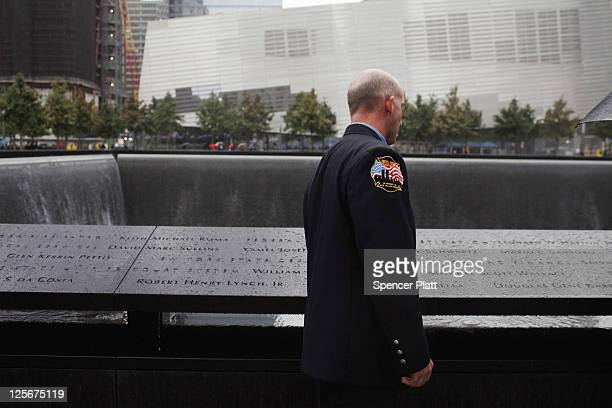 New York City firefighter looks for the names of colleagues killed on September 11 2001 during a first responders wreathlaying ceremony at the...