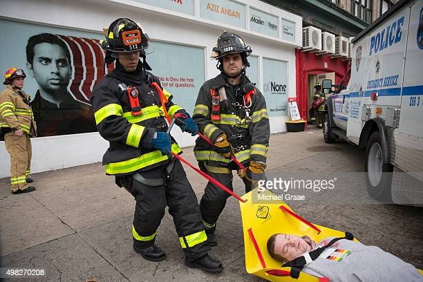 New York City Firefighters drag a wounded actor to safety during an active shooter drill on Kenmare St on November 22 2015 in New York City The drill...