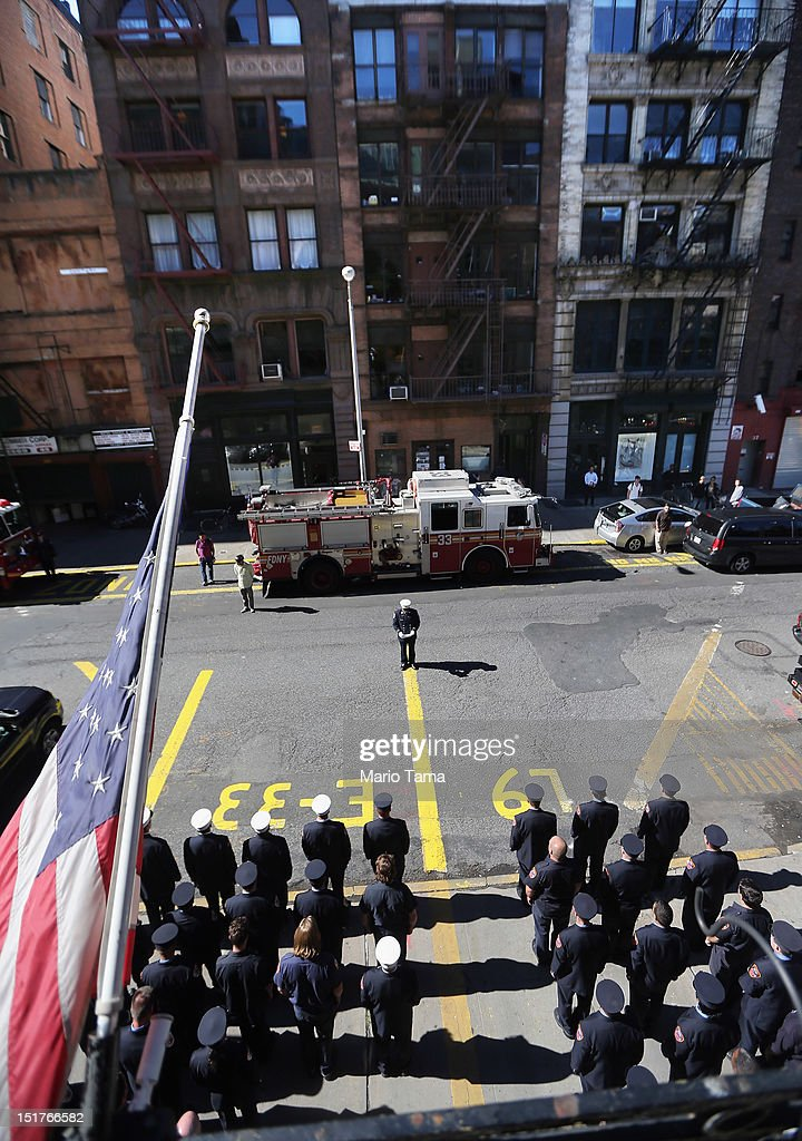 New York City firefighters of Engine 33, Ladder 9 observe a moment of silence during ceremonies for the eleventh anniversary of the terrorist attacks on lower Manhattan at the World Trade Center on September 11, 2012 in New York City. Engine 33, Ladder 9 lost ten firefighters in the attacks. New York City and the nation are commemorating the eleventh anniversary of the September 11, 2001 attacks which resulted in the deaths of nearly 3,000 people after two hijacked planes crashed into the World Trade Center, one into the Pentagon in Arlington, Virginia and one crash landed in Shanksville, Pennsylvania.