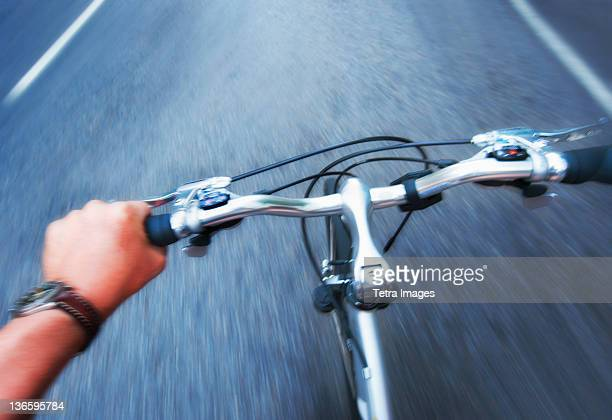 USA, New York City, Hand gripping handlebar of bike
