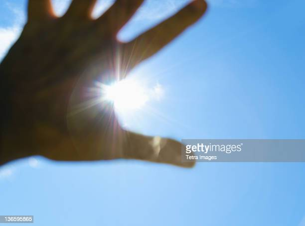 USA, New York City, Hand in front of sun