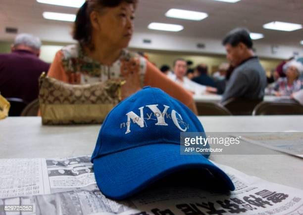A New York City hat sits on a newspaper at the Korean Community Services center on August 10 in New York Most of those at the center said they hope...