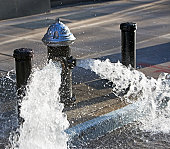USA, New York City, hydrant pouring out water