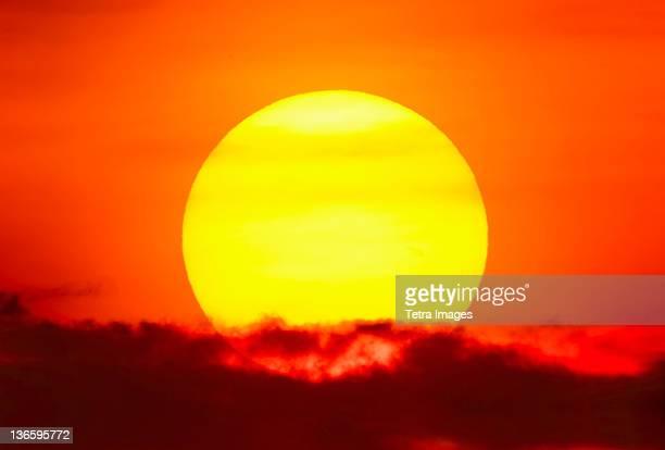 USA, New York City, Large sun at sunset