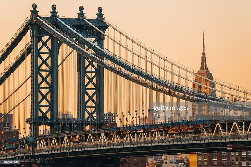 USA, New York City, Manhattan Bridge with Empire State Building