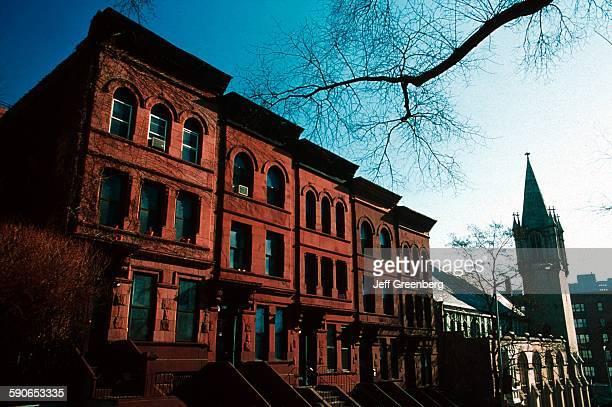 New York City Manhattan Harlem Brownstones And Church Along 141 Street