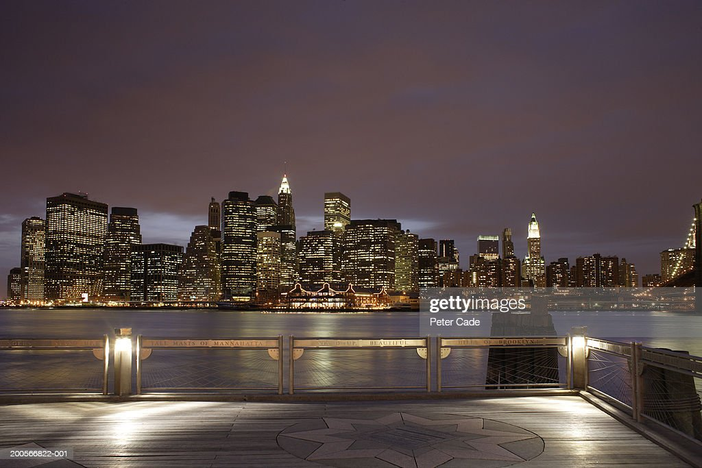 USA, New York City, Manhattan skyline at night seen from rooftop : Stock Photo