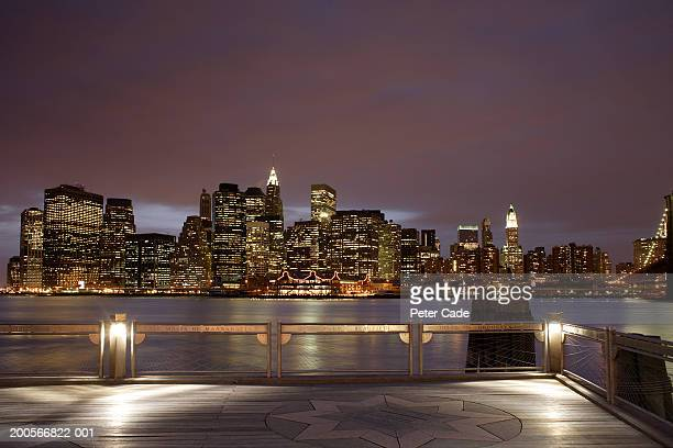 USA, New York City, Manhattan skyline at night seen from rooftop