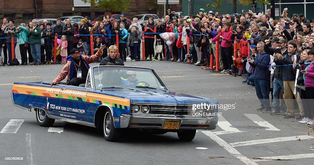 New York City Marathon race director Peter Ciaccia and Marathon Grand Marshal Spike Lee wave to the crowd as they pass by in the 2015 TCS New York...