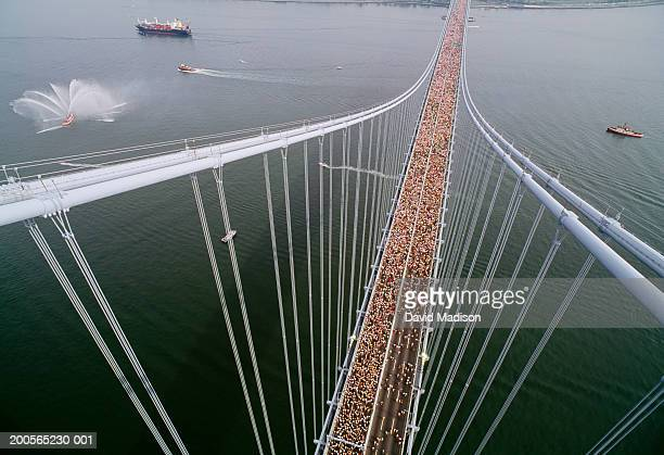 New York City marathon runners crossing Verrazano Bridge, aerial view