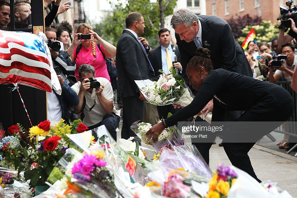 New York City Mayor Bill de Blasio and his wife Chirlane McCray pause in front of the iconic New York City gay and lesbian bar The Stonewall Inn to lay flowers and grieve for those killed in Orlando on June 13, 2016 in New York City. An American-born man who had recently pledged allegiance to ISIS killed 50 people early Sunday at a gay nightclub in Orlando, Florida. The massacre is the deadliest mass shooting in United States history.