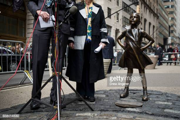 New York City Mayor Bill De Blasio and Manhattan Borough President Gail Brewer speak to reporters as they stand next to the 'Fearless Girl' statue...