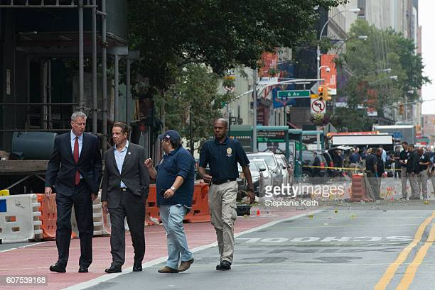 New York City Mayor Bill de Blasio and New York Gov Andrew Cuomo tour the site of the bomb blast on 23rd St in Manhattan's Chelsea neighborhood on...