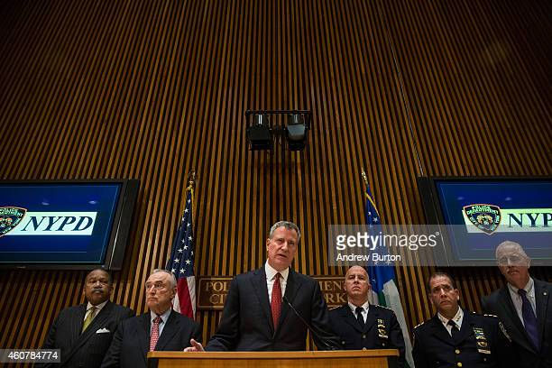 New York City Mayor Bill de Blasio and New York Police Department Commissioner Bill Bratton speak at a press conference regarding two police officers...
