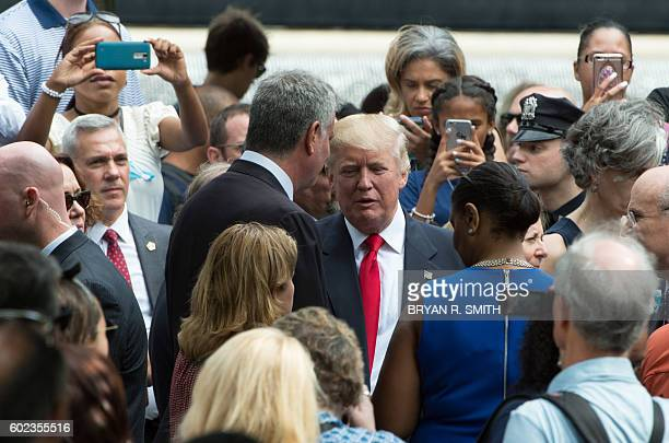 New York City Mayor Bill de Blasio and Republican presidential nominee Donald Trump speak during the 15th Anniversary of September 11 at the 9/11...