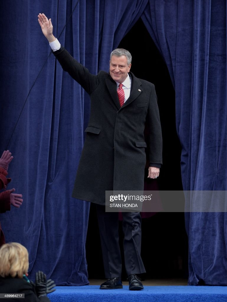 New York City Mayor Bill de Blasio arrives on the steps of City Hall in Lower Manhattan January 1 2014 in New York before his public inauguration...