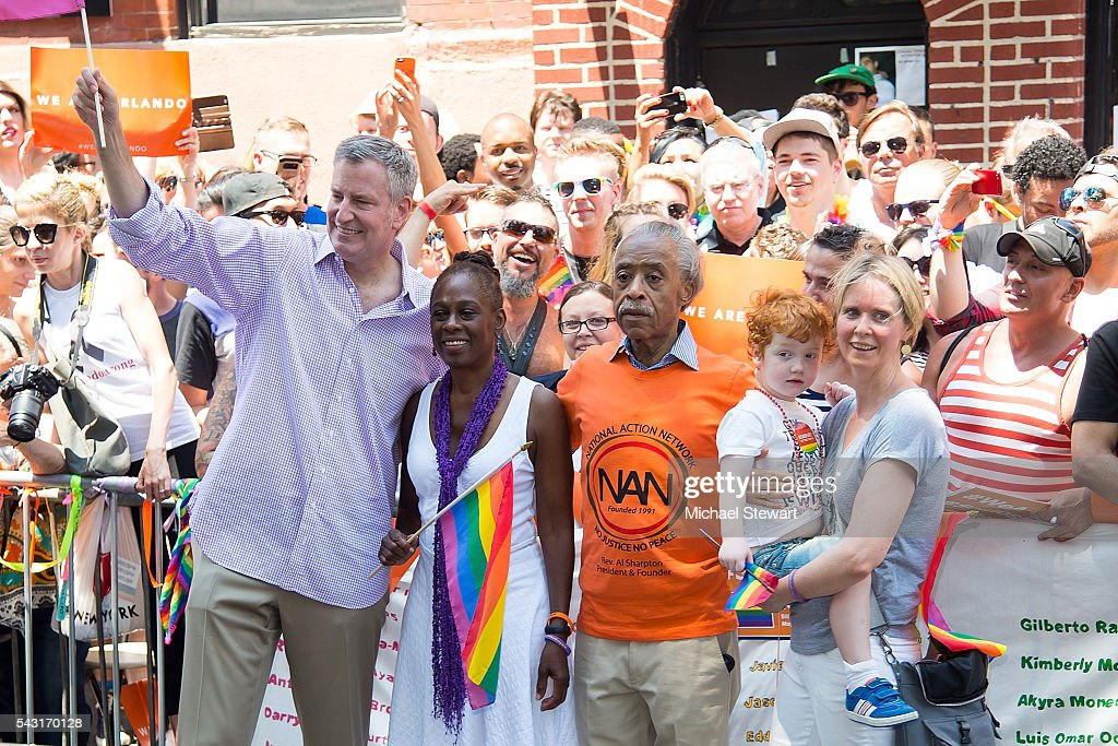 New York City Mayor <a gi-track='captionPersonalityLinkClicked' href=/galleries/search?phrase=Bill+de+Blasio&family=editorial&specificpeople=6224514 ng-click='$event.stopPropagation()'>Bill de Blasio</a>, <a gi-track='captionPersonalityLinkClicked' href=/galleries/search?phrase=Chirlane+McCray&family=editorial&specificpeople=8014891 ng-click='$event.stopPropagation()'>Chirlane McCray</a>, Reverend <a gi-track='captionPersonalityLinkClicked' href=/galleries/search?phrase=Al+Sharpton&family=editorial&specificpeople=202250 ng-click='$event.stopPropagation()'>Al Sharpton</a> and actress <a gi-track='captionPersonalityLinkClicked' href=/galleries/search?phrase=Cynthia+Nixon&family=editorial&specificpeople=202583 ng-click='$event.stopPropagation()'>Cynthia Nixon</a> attend the 2016 Pride March on June 26, 2016 in New York City.