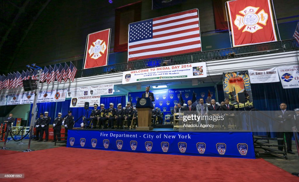 New York City Mayor Bill de Blasio (C) congratulates 2014 FDNY Medal Day Recipients for their exceptional acts of valor at the New York State Armory in Manhattan on June 4, 2014. The firefighters were honored for their heroic actions in the line of duty.