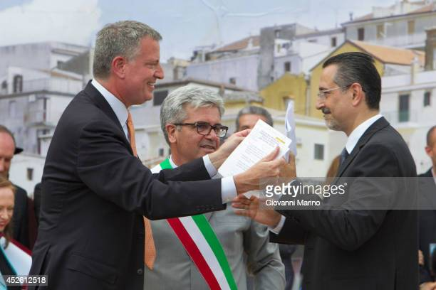 New York City mayor Bill De Blasio is greeted by Grassano mayor Francesco Sanseverino and and Basilicata Region president Marcello Pittella as he...