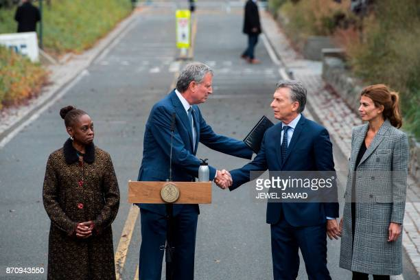 New York City Mayor Bill de Blasio shakes hands with Argentinas Presidnet Mauricio Macri during a ceremony on a bike path in New York on November 6...