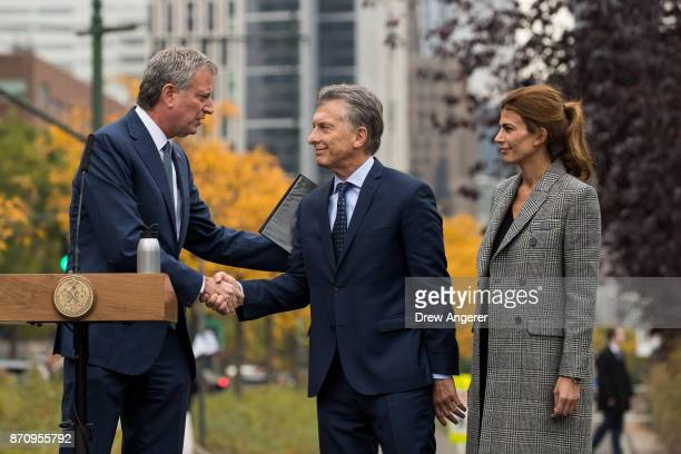 New York City Mayor Bill de Blasio shakes hands with Argentinian President Mauricio Macri as First Lady of Argentina Juliana Awada looks on during a...