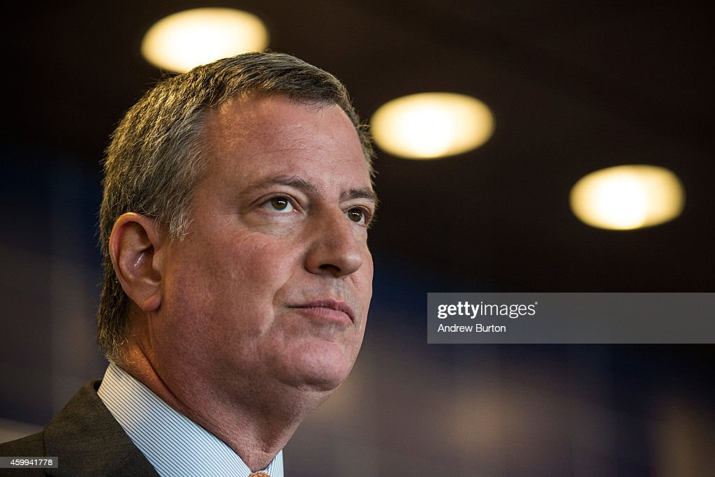 New York City Mayor <a gi-track='captionPersonalityLinkClicked' href=/galleries/search?phrase=Bill+de+Blasio&family=editorial&specificpeople=6224514 ng-click='$event.stopPropagation()'>Bill de Blasio</a> speaks at a press conference after witnessing police being retrained with new guidelines at the Police Academy on December 4, 2014 in the College Point neighborhood of the Queens borough of in New York City. The new police guidelines come on the heels of numerous national incidences where white police officers have killed black men.